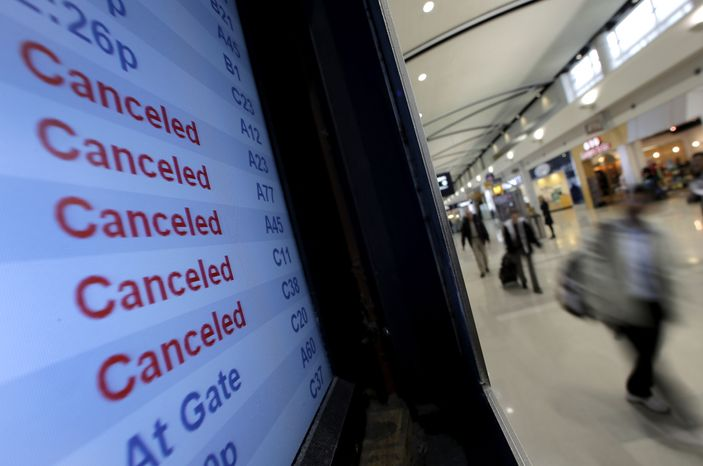 A Delta Air Lines departures monitor shows flights canceled because of Hurricane Sandy on Monday, Oct. 29, 2012, at Detroit Metropolitan Wayne County Airport outside Detroit. (AP Photo/Charlie R
