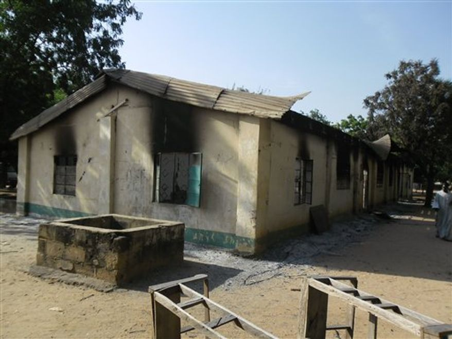 Burnt out school block following a gun battle and explosions by the Boko Haram sect in Potiskum, Nigeria, Saturday, Oct. 20 , 2012. A Chinese construction worker has been killed in a besieged city in Nigeria's northeast, an official said, exacerbating security concerns for foreign workers in Nigeria's violence-wracked northeast. (AP Photo/Adamu Adamu)