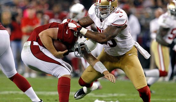 Arizona Cardinals quarterback John Skelton (19) avoids a sack by San Francisco 49ers outside linebacker Ahmad Brooks (55) during the second half of an NFL football game on Monday, Oct. 29, 2012, in Glendale, Ariz. The 49ers won 24-3. (AP Photo/Ross D. Franklin)