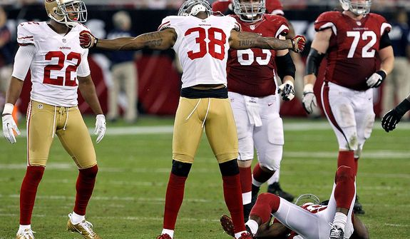 San Francisco 49ers free safety Dashon Goldson (38) celebrates his hit on Arizona Cardinals wide receiver Andre Roberts during the second half of an NFL football game on Monday, Oct. 29, 2012, in Glendale, Ariz. The 49ers won 24-3. (AP Photo/Ross D. Franklin)