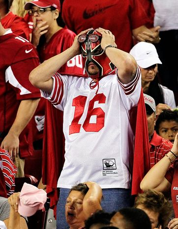 An Arizona Cardinals fan reacts to his team during the second half of an NFL football game against the San Francisco 49ers on Monday, Oct. 29, 2012, in Glendale, Ariz. (AP Photo/Matt York)