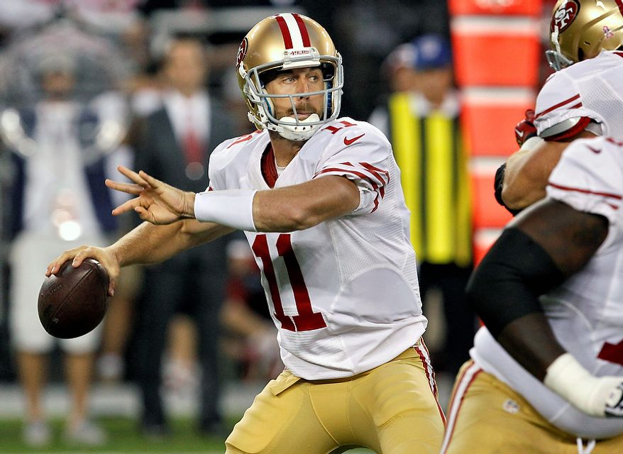 San Francisco 49ers quarterback Alex Smith (11) drops back to pass against the Arizona Cardinals during the first half of an NFL football game, Monday, Oct. 29, 2012, in Glendale, Ariz.  (AP Photo/Ross D. Franklin)