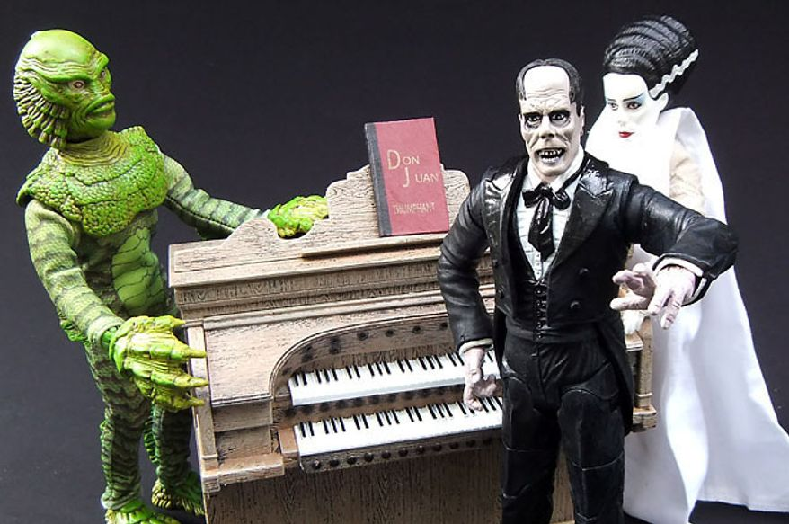 Diamond Select Toys's The Phantom of the Opera, Creature from the Black Lagoon and Bride of Frankenstein reminisce about the old days. (Photograph by Joseph Szadkowski / The Washington Times)