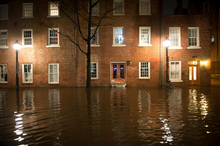A building on S. Union Street is seen with flood water from the Potomac River late into the night in Alexandria, Va., Tuesday, Oct. 30, 2012, the day after Hurricane Sandy slammed into the region. (Rod Lamkey Jr./The Washington Times)