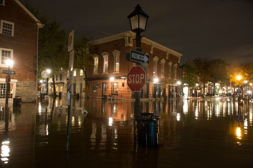The intersection of King and S. Union Streets is submerged in flood water from the Potomac River late into the night in Alexandria, Va., Tuesday, Oct. 30, 2012, the day after Hurricane Sandy slammed into the region. (Rod Lamkey Jr./The Washington Times)