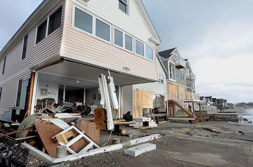Wreckage lies outsice damaged beach front homes after superstorm Sandy in Milford, Conn., Tuesday, Oct. 30, 2012. (AP Photo/Jessica Hill)