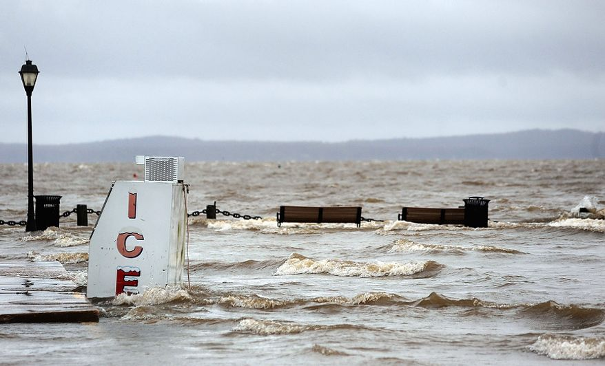 A park floods along the Susquehanna River in Havre de Grace, Md. is flooded as the aftermath of superstorm Sandy continues to disrupt routines on the East Coast Tuesday, Oct. 30, 2012. (AP Photo/Steve Ruark)