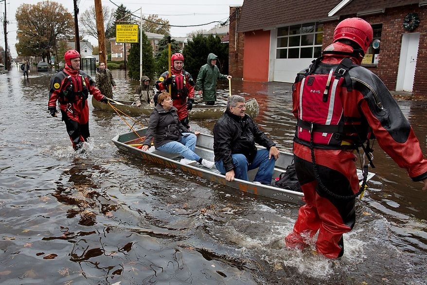 Rescuers bring people out by boat in Little Ferry, N.J., Tuesday, Oct. 30, 2012, in the wake of superstorm Sandy. Sandy arrived along the East Coast and morphed into a huge and problematic system, putting more than 7.5 million homes and businesses in the dark and causing a number of deaths. (AP Photo/Craig Ruttle)