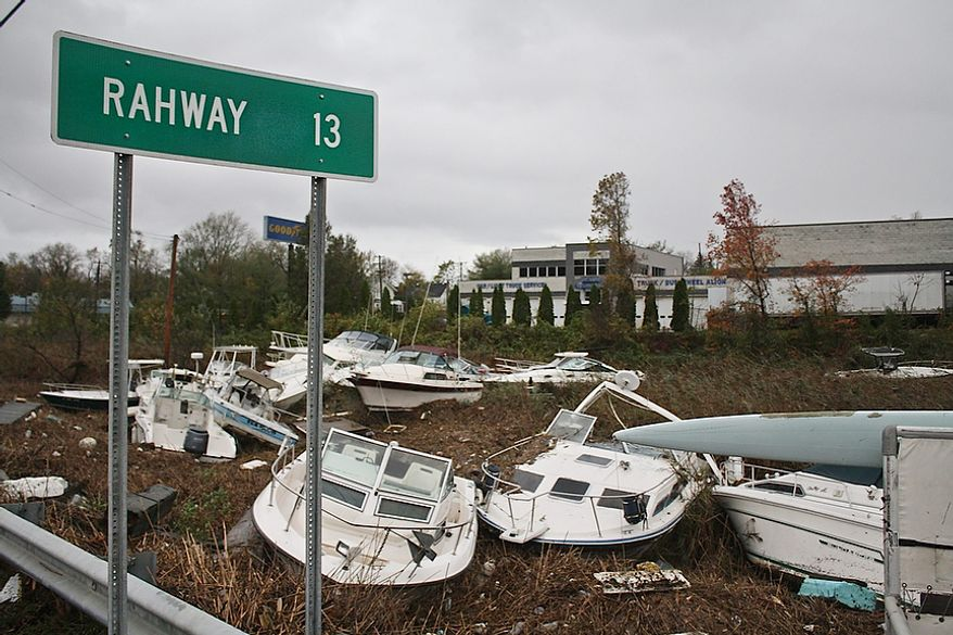Pleasure boats pile up 30 yards or more from the waterís edge in the wake of Hurricane Sandy, Tuesday, Oct. 30, 2012, in the Cliffwood Beach section of Aberdeen, N.J. The storm's high winds and the high astronomical tide paired up to rip the boats away from their dock and deposit them on shore. (AP Photo/Peter Hermann, III)