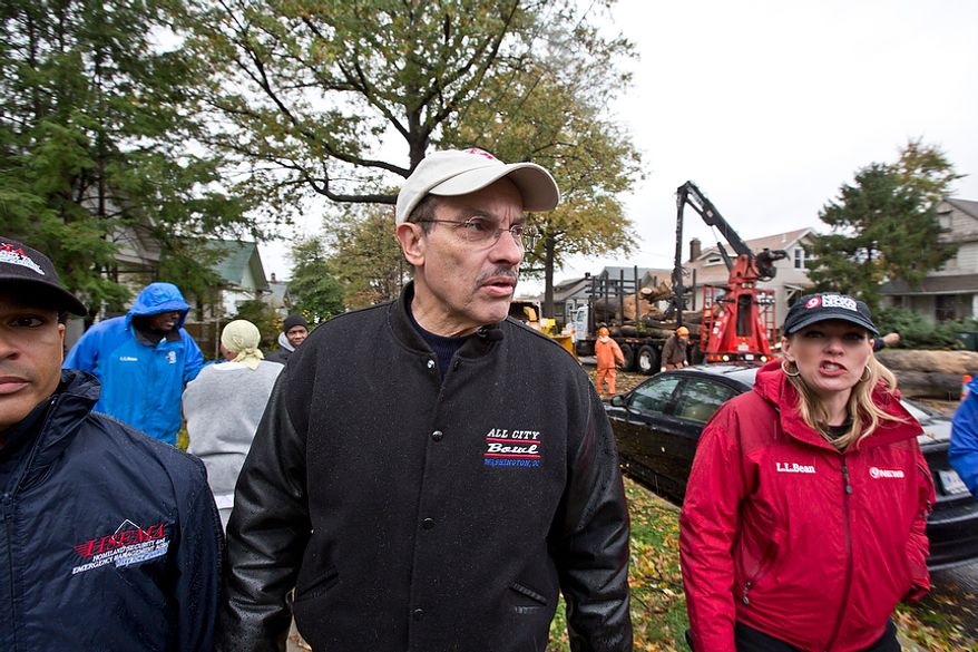 Mayor Vince Gray visits a residential area affected by hurricane Sandy, where a downed tree has blocked the road in Washington, D.C., Tuesday, October 30, 2012. Mayor Gray surveys the damage as part of his job as Mayor of D.C., to ensure residents are taken care of. (Andrew S. Geraci/The Washington Times)