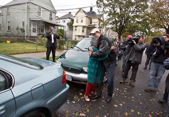 Mayor Vince Gray hugs a resident affected by hurricane Sandy, on Evarts St NE, Washington, D.C., Tuesday, October 30, 2012. Mayor Gray surveys the damage as part of his job as Mayor of D.C., to ensure residents are take