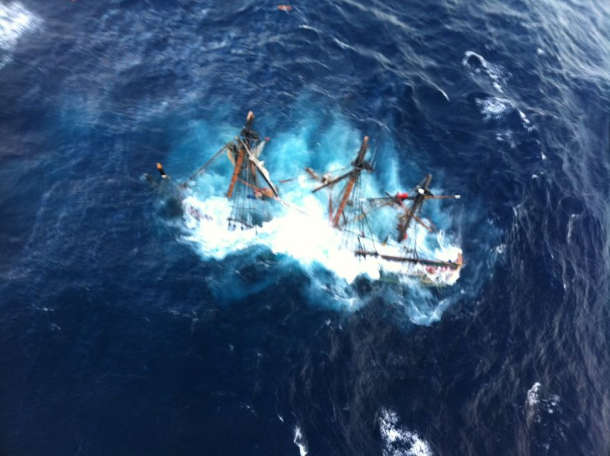 This photo provided by the U.S. Coast Guard shows the HMS Bounty, a 180-foot sailboat, submerged in the Atlantic Ocean during Hurricane Sandy, approximately 90 miles southeast of Hatteras, N.C., on Monday, Oct. 29, 2012. The Coast Guard rescued 14 of the 16 crew members by helicopter. Hours later, rescuers found one of the missing crew members, but she was unresponsive and later was declared dead. They are still searching for the captain. (AP Photo/U.S. Coast Guard, Petty Officer 2nd Class Tim Kuklewski)
