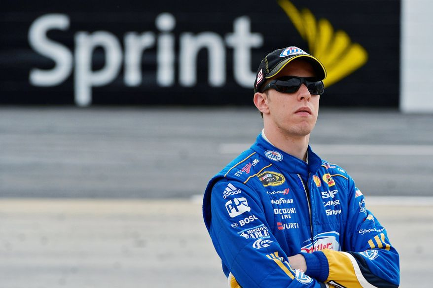 Brad Keselowski watches during qualifying for Sunday's NASCAR Sprint Cup Series auto race at Martinsville Speedway, Friday, Oct. 26, 2012, in Martinsville, Va. (AP Photo/Autostock, Brian Czobat) MANDATORY CREDIT