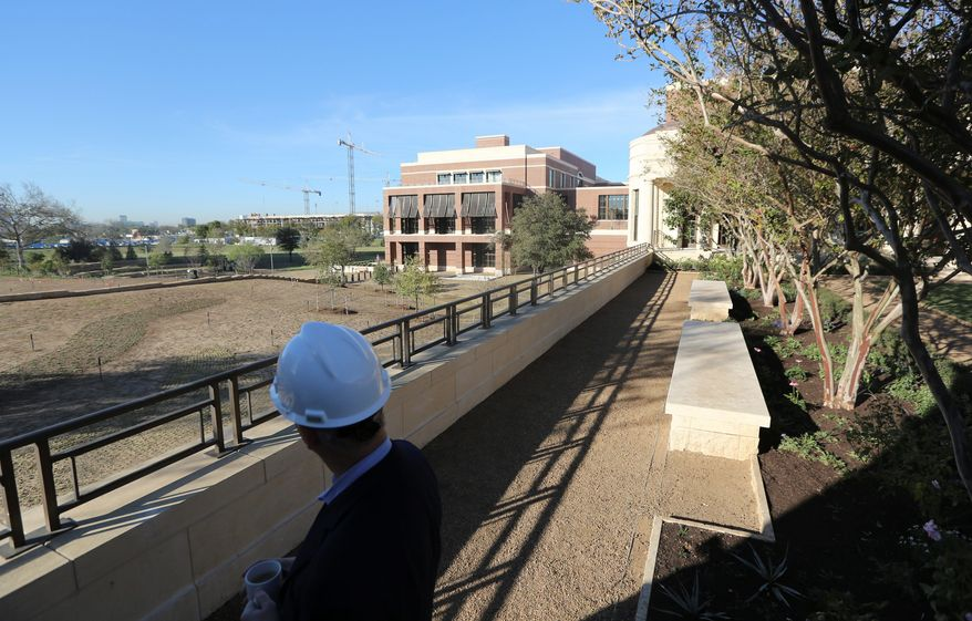 Mark Langdale, president of the George W. Bush Foundation, looks at the landscaping at the George W. Bush Presidential Center on the campus of Southern Methodist University in Dallas. It will feature a library, museum and 15-acre park. (Associated Press)