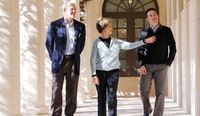 Former first lady Laura Bush talks with landscape architect Herb Sweeney (right) and Mark Langdale, president of the George W. Bush Foundation, during a tour of the Texas interpretation of the White House Rose Garden at the George W. Bush Presidential Center in Dallas, which will open in late April. (Associated Press)