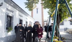 associated press U.S. Secretary of State Hillary Rodham Clinton leaves St. Nicholas Orthodox Church in Pristina, Kosovo, after meeting Wednesday with ethnic Serbs, who want independence or incorporation into an expanded Serbia. The U.S. and EU say that is not possible.