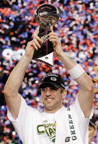 Green Bay Packers' Aaron Rodgers holds the Vince Lombardi Trophy after the Packers' 31-25 win over the Pittsburgh Steelers in the NFL Super Bowl XLV football game Sunday, Feb. 6, 2011, in Arlington, Texas. R