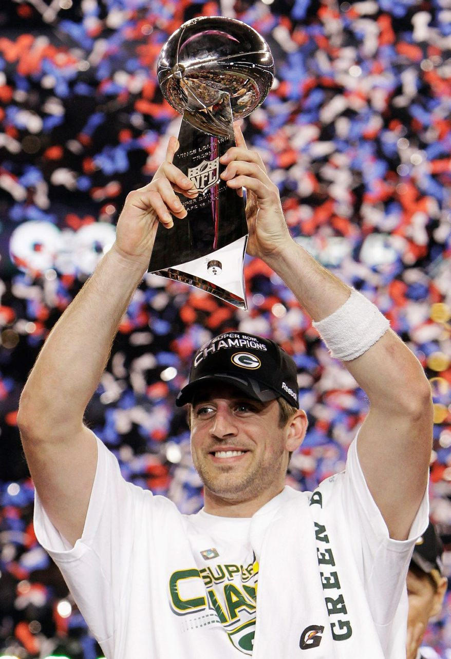 Green Bay Packers' Aaron Rodgers holds the Vince Lombardi Trophy after the Packers' 31-25 win over the Pittsburgh Steelers in the NFL Super Bowl XLV football game Sunday, Feb. 6, 2011, in Arlington, Texas. Rodgers was named most valuable player of the game. (AP Photo/Mark Humphrey)