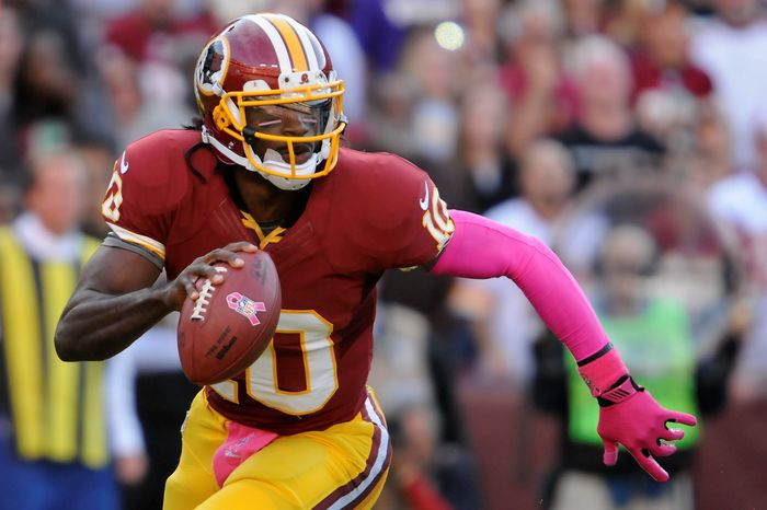 Washington Redskins quarterback Robert Griffin III (10) scrambles out of the pocket before throwing an interception in the first quarter at FedEx Field, Landover, Md., Oct. 14, 2012. (Preston Keres/Special to The Washington Times)