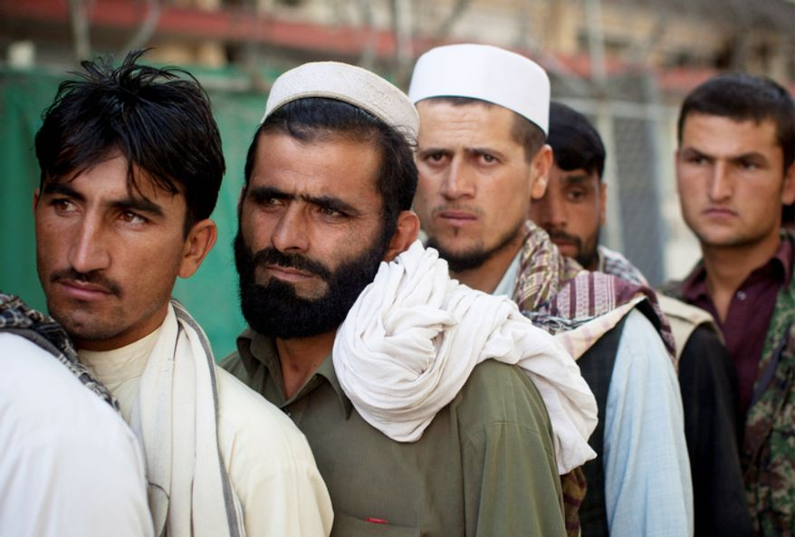 Men line up to join the Afghan National Police force outside the registration center in Kabul, Afghanistan. On average 10 policemen die every day in Afghanistan.  (AP Photo/Anja Niedringhaus)