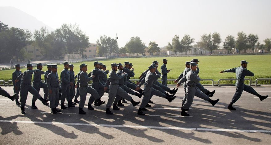 Recruits exercise in formation at the National Police Academy in Kabul, Afghanistan. (AP Photo/Anja Niedringhaus)