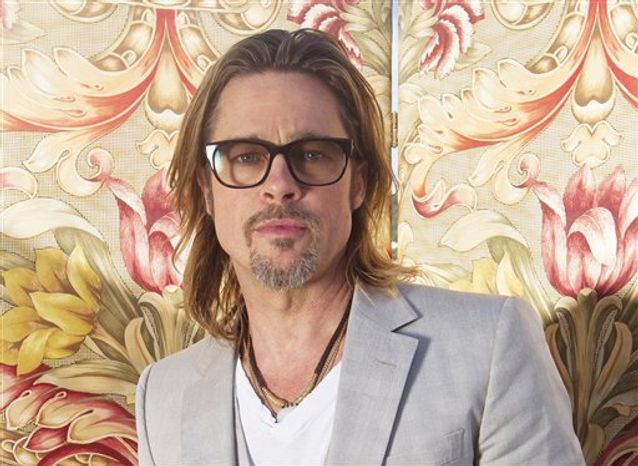 FILE - This May 23, 2012 file photo shows actor Brad Pitt posing for portraits during the 65th Cannes Film Festival in Cannes, France. Pitt has agreed to donate $100,000 to help the Human Rights Campaign raise money for its efforts to support same-sex marriage initiatives in several states.The nation's largest gay rights group announced Wednesday, Oct. 31, that Pitt agreed to match contributions from the group's members up to $100