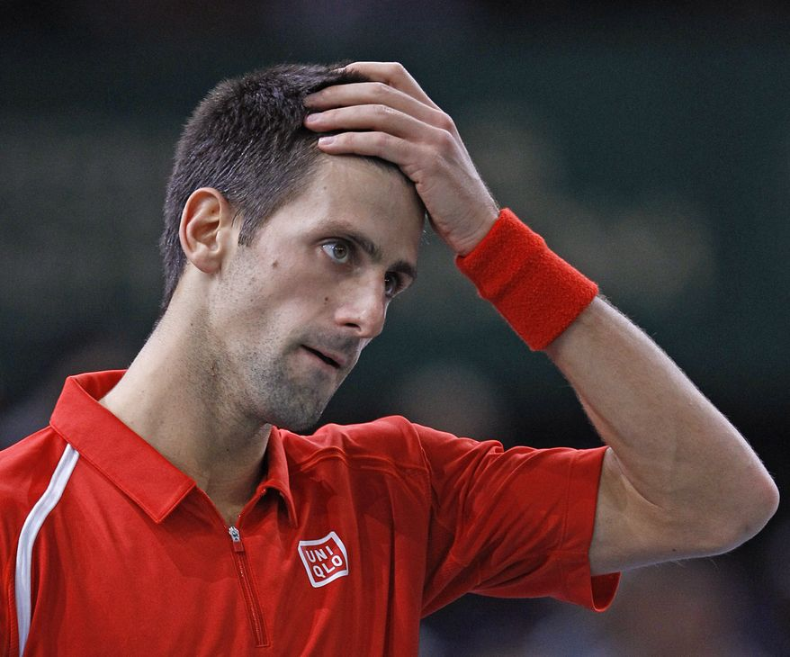 Serbia's player Novak Djokovic reacts during his match against Sam Querrey of the U.S. at the Paris Tennis Masters tournament, Wednesday, Oct. 31, 2012. Sam Querrey defeated Novak Djokovic. (AP Photo/Remy de la Mauviniere)