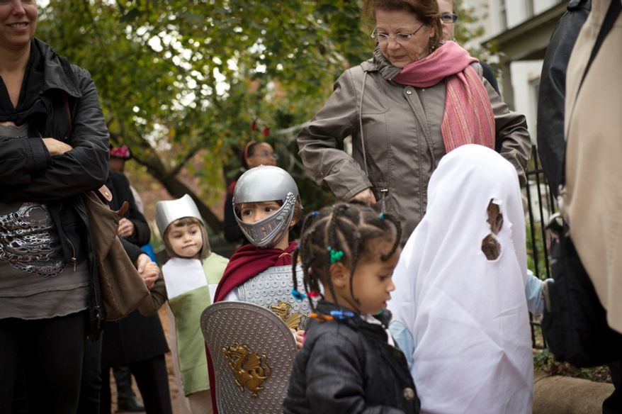 Kids from the AppleTree Early Learning Public Charter School Lincoln Park Campus take part in their Halloween parade in Washington, D.C., Wednesday, Oct. 31, 2012. (Rod Lamkey Jr./The Washington Times)
