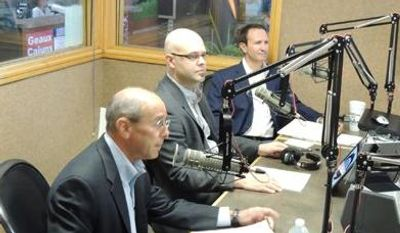 U.S. Reps. Charles Boustany Jr., foreground, and Jeff Landry, back, prepare to debate in a radio studio in Lafayette, La., on Wednesday. Between the Republicans is Jeremy Lawrence, the moderator, of KPEL-FM. Dr. Boustany and Mr. Landry were placed in the same district by redistricting and are locked in a contentious re-election battle. (Robert Buckman/Special to The Washington Times)