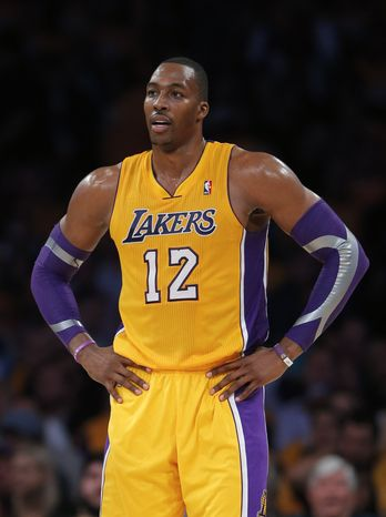 Los Angeles Lakers' Dwight Howard looks on in the second half of an NBA basketball game against the Dallas Mavericks in Los Angeles, Tuesday, Oct. 30, 2012. The Maver