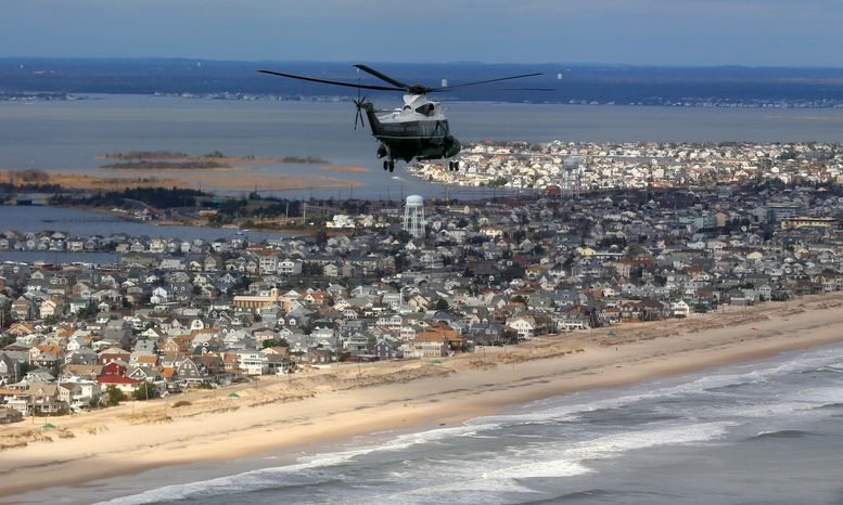 Marine One, the presidential helicopter, with President Obama and New Jersey Gov. Chris Christie on board, flies over the New Jersey shoreline in areas damaged by superstorm Sandy, on Wednesday, Oct. 31, 2012. (AP Photo/Doug Mills, Pool)