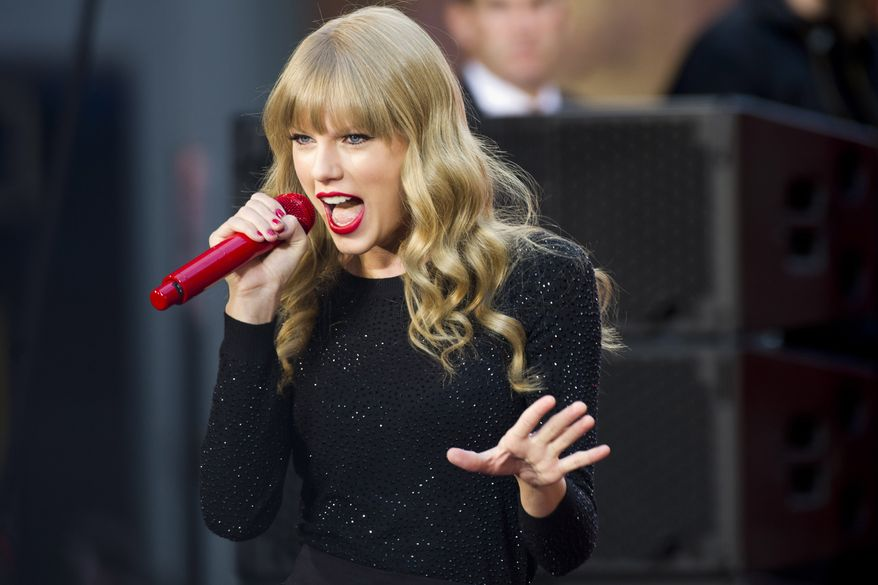 "Taylor Swift performs on ABC's ""Good Morning America"" in New York on Tuesday, Oct. 23, 2012. (Charles Sykes/Invision/AP)"