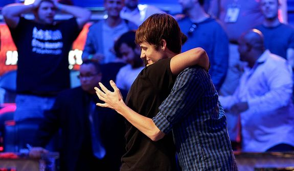 Jake Balsiger hugs Jesse Sylvia after being eliminated from play to finish third during the World Series of Poker Final Table event, Wednesday, Oct. 31, 2012, in Las Vegas. (AP Photo/Julie Jacobson)