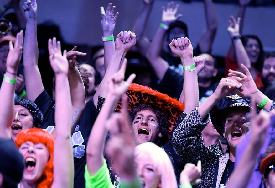 Fans for player Jesse Sylvia cheer him on during the World Series of Poker Final Table event, Tuesday, Oct. 30, 2012, in Las Vegas. (AP Photo/Julie Jacobson)