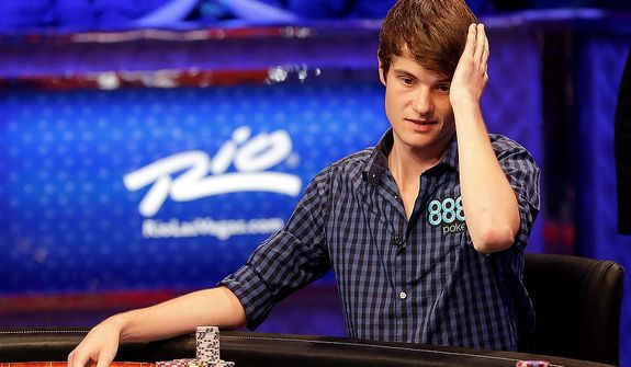 In the ninth hour of play, Jake Balsiger watches play from opponents during the World Series of Poker Final Table event, early Wednesday, Oct. 31, 2012, in Las Vegas. (AP Photo/Julie Jacobson)
