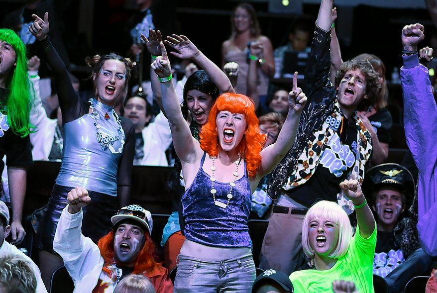 Fans cheer for Jesse Sylvia during the World Series of Poker Final Table event, Tuesday, Oct. 30, 2012, in Las Vegas. (AP Photo/Julie Jacobson)