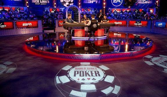 From left, Jake Balsiger, Greg Merson and Jesse Sylvia begin play during the World Series of Poker Final Table event, Tuesday, Oct. 30, 2012, in Las Vegas. (AP Photo/Julie Jacobson)