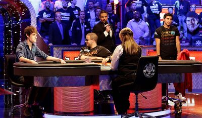 From left, Jake Balsiger, Greg Merson, and Jesse Sylvia watch the flop after Balsiger bet all in on a hand during the World Series of Poker Final Table event, Tuesday, Oct. 30, 2012, in Las Vegas. Balsiger won the pot on the hand. (AP Photo/Julie Jacobson)