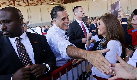 Republican presidential candidate, former Massachusetts Gov. Mitt Romney shakes hands with supporters during a campaign stop in Tampa, Fla., Wednesday, Oct. 31, 2012. (AP Photo/Charles Dharapak)