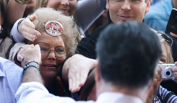 Republican presidential candidate, former Massachusetts Gov. Mitt Romney greets supporters as he campaigns in Tampa, Fla., Wednesday, Oct. 31, 2012. (AP Photo/Charles Dharapak)