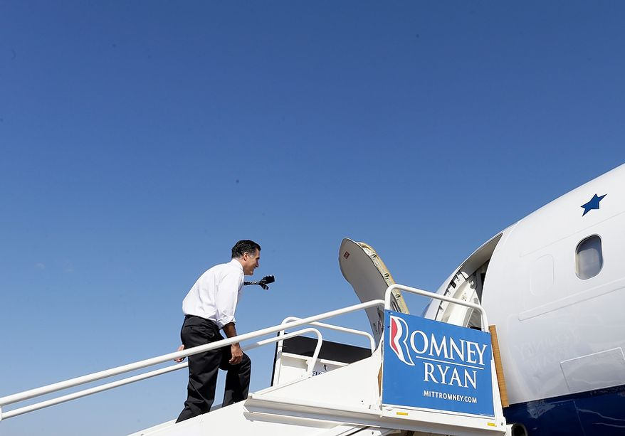 Republican presidential candidate, former Massachusetts Gov. Mitt Romney boards his campaign plane in Tampa, Fla., Wednesday, Oct. 31, 2012, as he flies to campaign events in Miami, Fla. (AP Photo/Charles Dharapak)