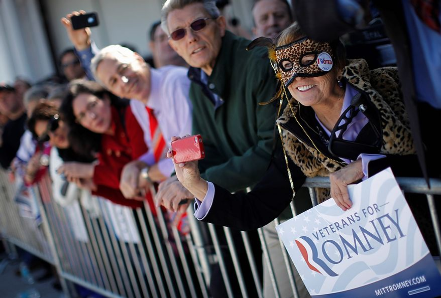 Wearing a mask on Halloween, Carol Heye of Riverview, Fla., shows her support for Republican presidential candidate, former Massachusetts Gov. Mitt Romney as he campaigns in Tampa, Fla., Wednesday, Oct. 31, 2012. (AP Photo/Charles Dharapak)