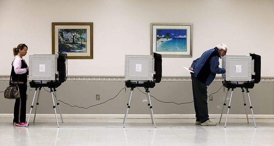Ellen Hoffman, left, and James Gibson cast their ballots at a polling place at the Wicomico County Youth and Civic Center in Salisbury, Md., Wednesday, Oct. 31, 2012,  after superstorm Sandy passed through the area. Early voting resumed in Maryland Wednesday after two days of cancellations due to superstorm Sandy. (AP Photo/Alex Brandon) ** FILE **