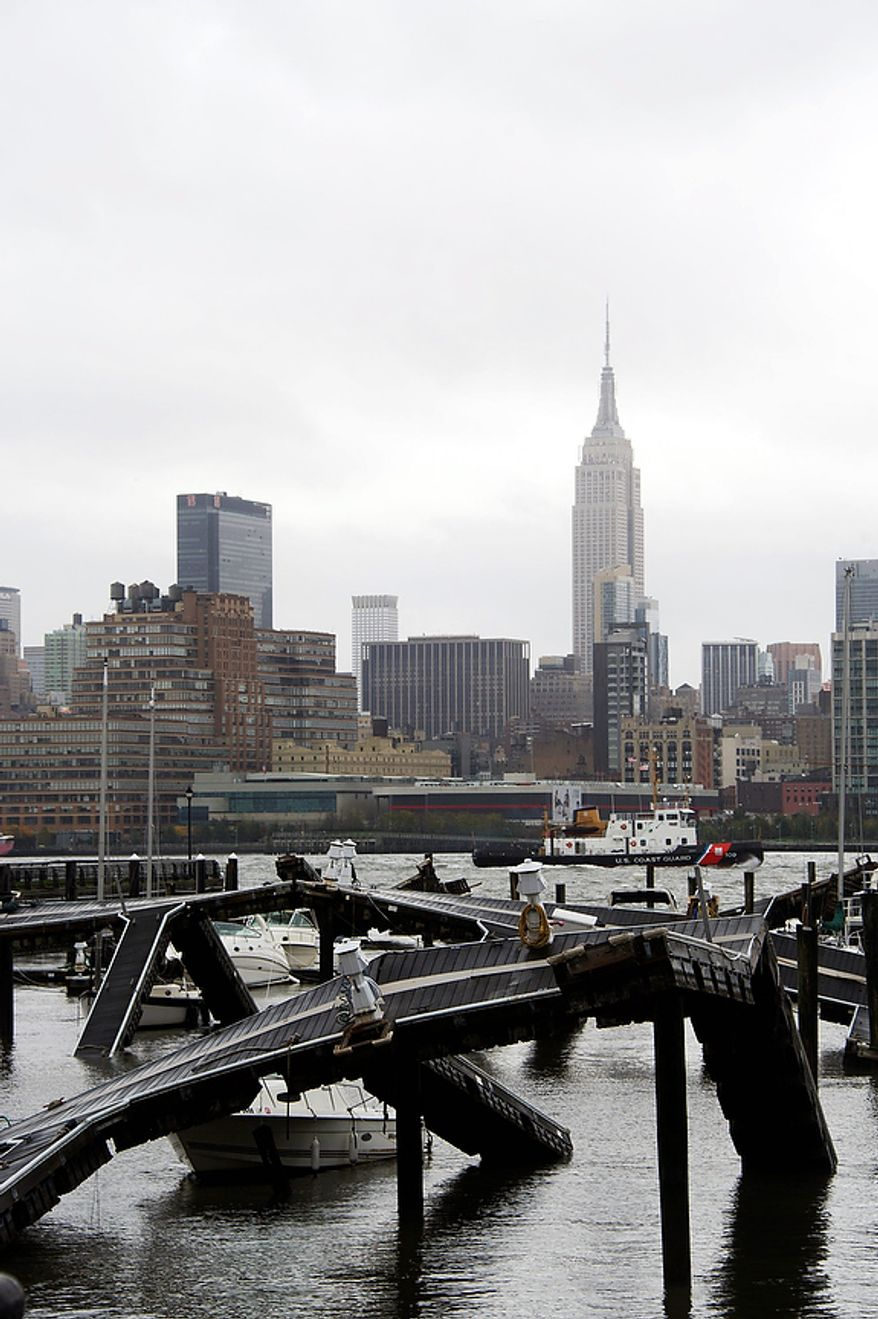 The twisted remains of a Hudson River marina are seen across from New York City as a result of superstorm Sandy on Tuesday, Oct. 30, 2012 in Hoboken, NJ. Sandy, the storm that made landfall Monday, caused multiple fatalities, halted mass transit and cut power to more than 6 million homes and businesses. (AP Photo/Charles Sykes)