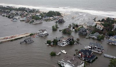 This Oct. 30, 2012 aerial photo provided by the U.S.Air Force shows flooding on the New Jersey shoreline during a search and rescue mission by 1-150 Assault Helicopter Battalion, New Jersey Army National Guard. By late Tuesday, the winds and flooding inflicted by the fast-weakening Superstorm Sandy had subsided, leaving at least 55 people dead along the Atlantic Coast and splintering beachfront homes and boardwalks from the mid-Atlantic states to southern New England. (AP Photo/U.S. Air Force, Master Sgt. Mark C. Olsen)