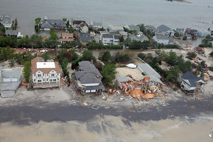 This Oct. 30, 2012 aerial photo provided by the U.S. Air Force shows damage to the New Jersey shoreline during a search and rescue mission by 1-150 Assault Helicopter Battalion, New Jersey Army National Guard. By late Tuesday, the winds and flooding inflicted by the fast-weakening superstorm Sandy had subsided, leaving at least 55 people dead along the Atlantic Coast and splintering beachfront homes and boardwalks from the mid-Atlantic states to southern New England. (AP Photo/U.S. Air Force, Master Sgt. Mark C. Olsen)