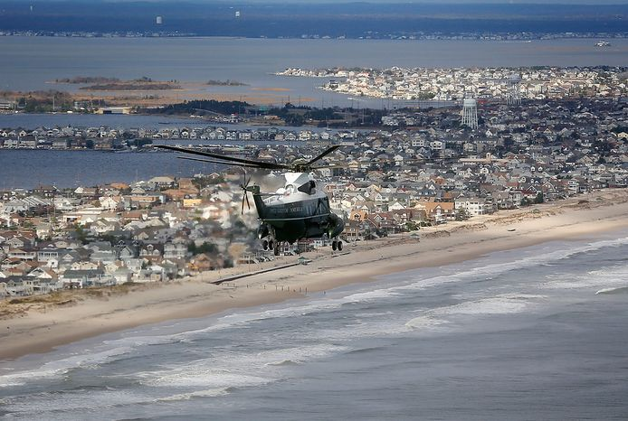 Marine One, carrying President Barack Obama and New Jersey Gov. Chris Christie, takes an aerial tour of the Atlantic Coast in New Jersey in areas damaged by superstorm Sandy, Wednesday, Oct. 31, 2012. (AP Photo/Doug Mills, The New York Times, Pool)