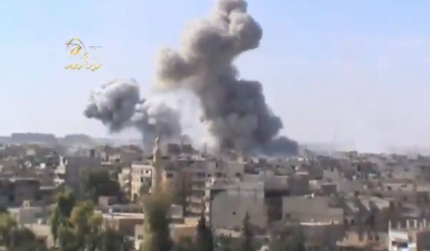 This image taken from video obtained from the Ugarit news network, which has been authenticated based on its contents and other AP reporting, shows smoke rising following heavy bombing from military warplanes in Deir el-Zour's Jbeileh neighborhood, 450 km northeast of Damascus, Syria, on Monday, Oct. 29, 2012. Syrian warplanes launched 60 airstrikes against rebel targets around the country on Monday, the most intense air raids across the country since the uprising began 19 months ago, according to anti-regime activists. Activists said at least 500 people were killed over the four-day period ending Monday when a U.N.-backed truce was supposed to be in effect. They said the death toll for Monday so far has reached 80. (AP Photo/Shaam News Network via AP video)