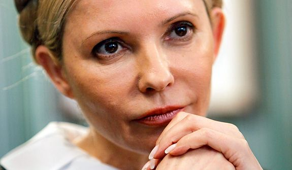 ** FILE ** In this Monday, April 4, 2011, photo, Yulia Tymoshenko, former Ukrainian prime minister and main opposition leader, is pictured in her headquarters in Kiev. Tymoshenko's party alleged widespread elections violations, such as vote-buying and multiple voting, and the jailed leader, who is currently undergoing treatment for a back problem in a Ukrainian hospital, launched a hunger strike in protest. (AP Photo/Efrem Lukatsky)