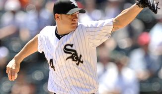 FILE - In this May 15, 2012, file photo, Chicago White Sox starter Jake Peavy delivers a pitch in the first inning of a baseball game against the Detroit Tigers in Chicago. Peavy and the White Sox agreed Tuesday, Oct. 30, to a $29 million, two-year contract. (AP Photo/Paul Beaty, File)